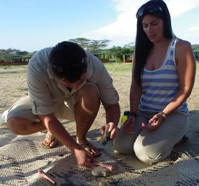 Wesley and Jenna smashing a bone to get the marrow.