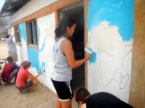 Students cover the white of the wall with a beautiful light blue.
