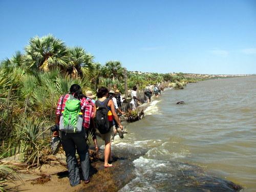 The group trek through along the coast
