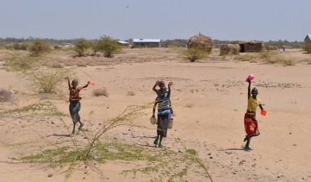 Turkana children waving as we pass through a village