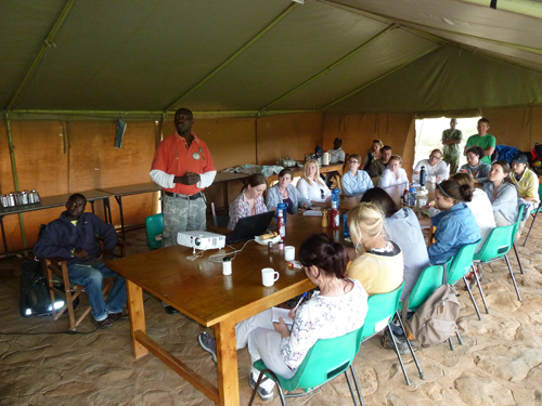 Steven Ekwanga talks to the students about lion conservation