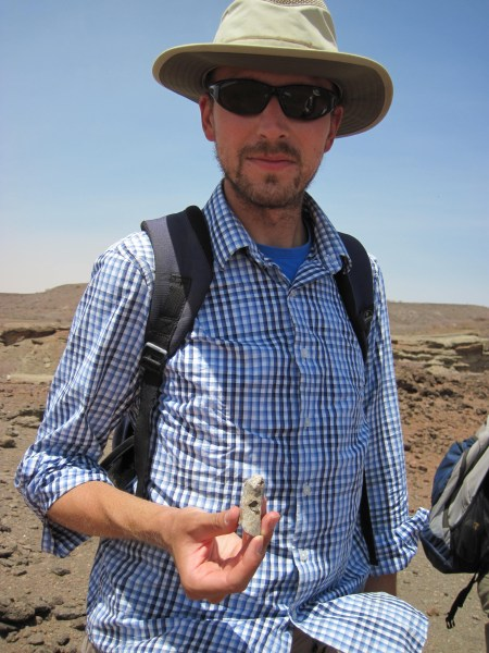 Mike with an unknown fossil fragment.