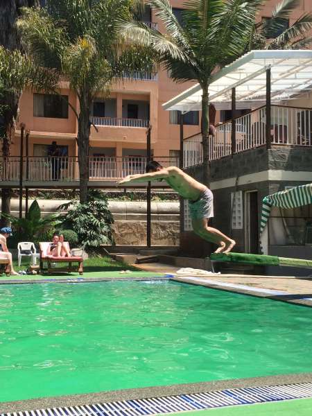 Ryan jumping off the diving board at a hotel pool we visited in town....last time we would be around such luxuries!