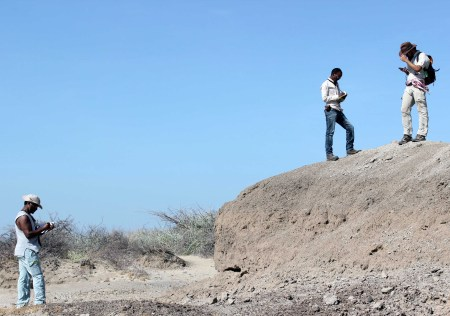 Tadele, Yemane and Evan record GPS points to map the extent of the Ileret volcanic ash (tuff).