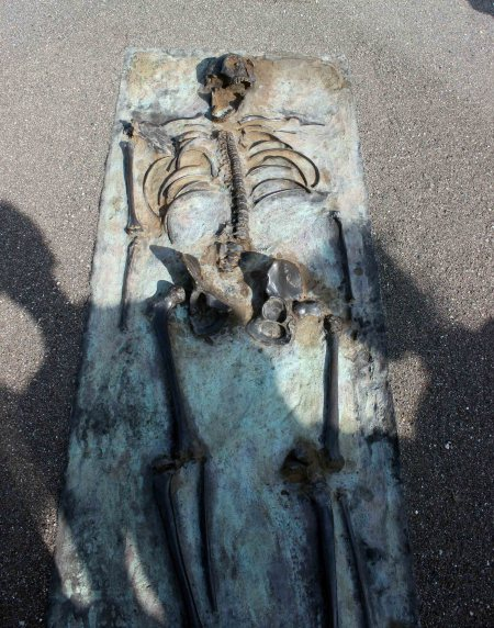 The monument is complete with a metal cast of the skeleton in its original position when it was found.