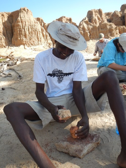 Francis, who works for TBI, showed the students how he often processes the palm nuts