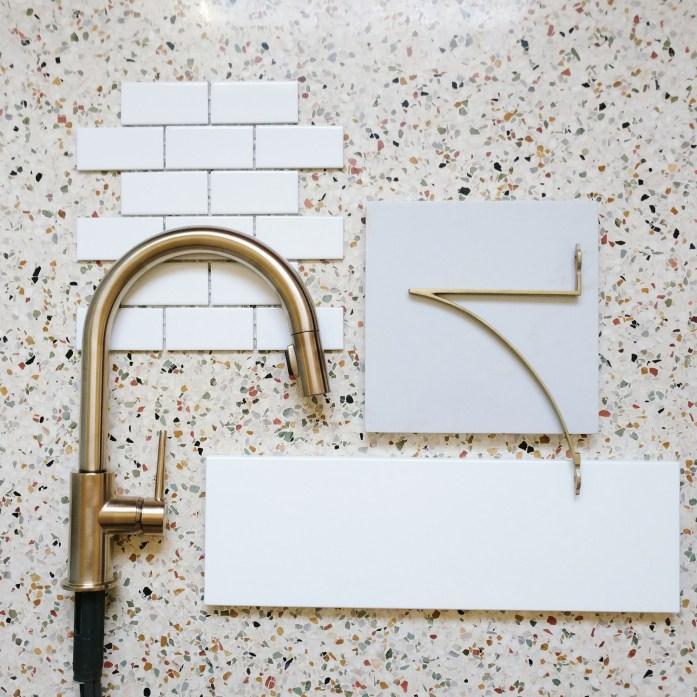 brass, quartz, terrazzo, subway tile