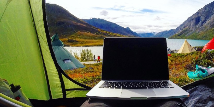 Digital nomad working from tent