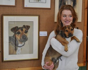 Sophie with our dog Bali who she painted. This pastel won her Best in Show in her first exhibition.
