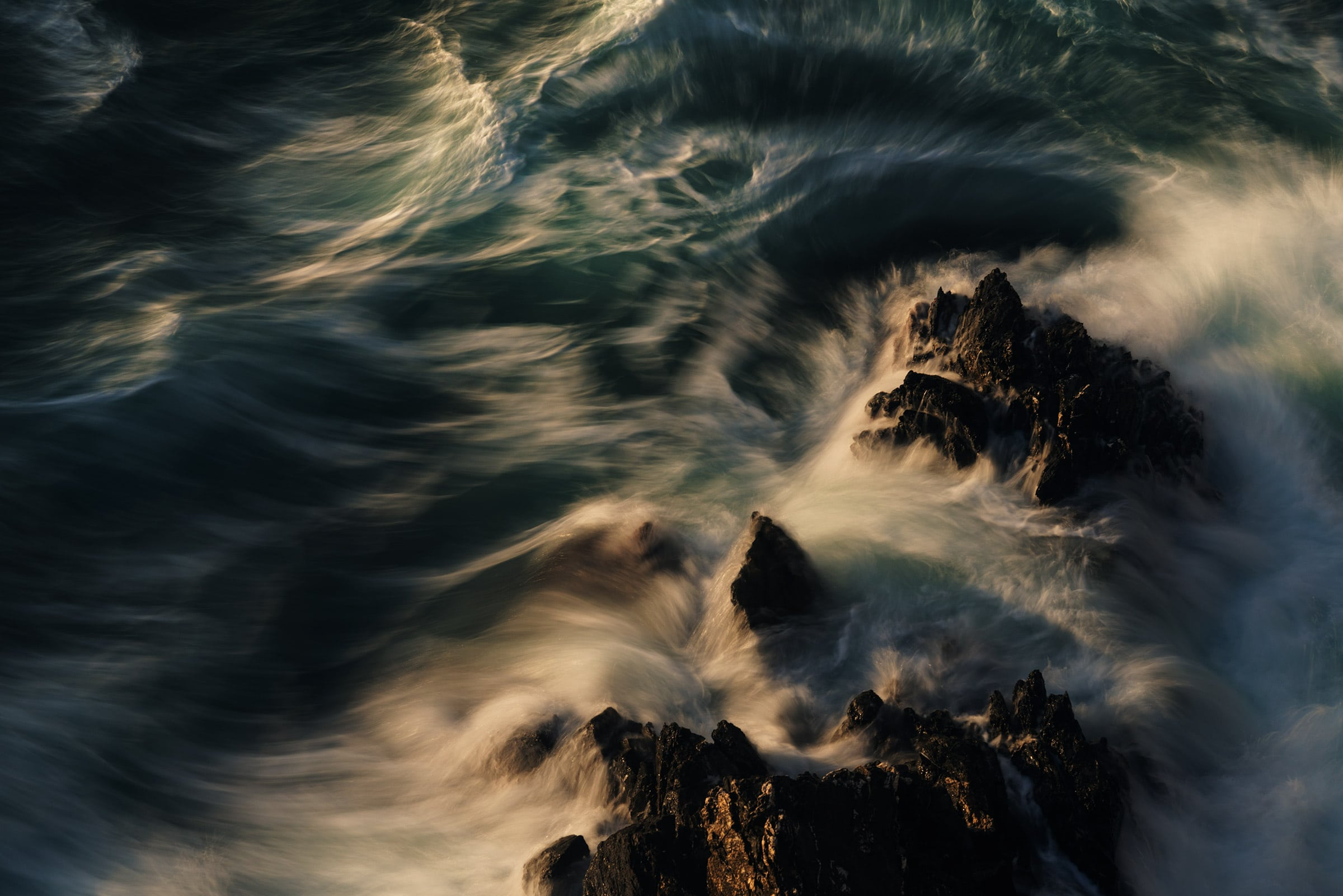 Sea waves hit by the sunset light in Cinque Terre photo tour