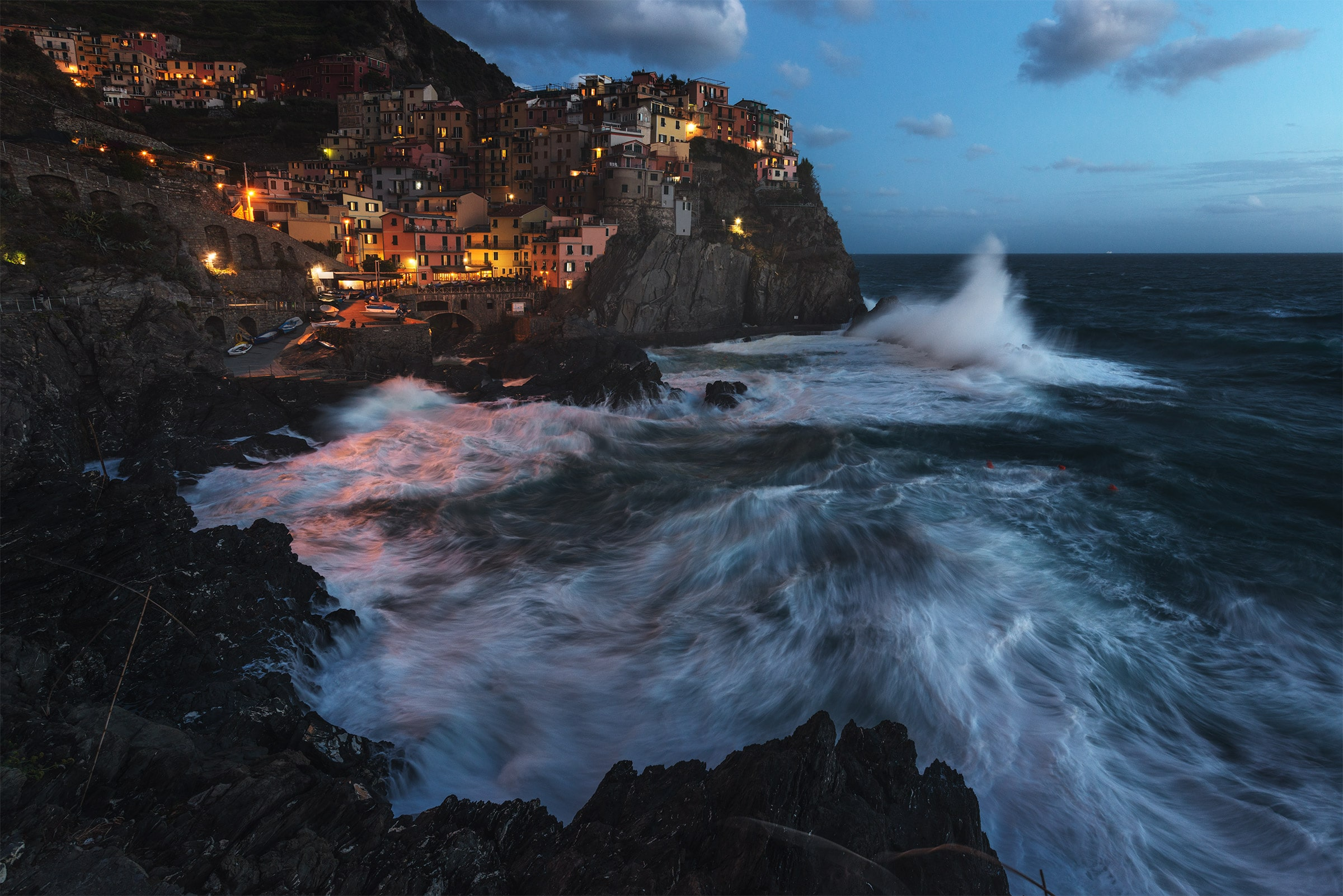 Manarola with sea storm at blue hour