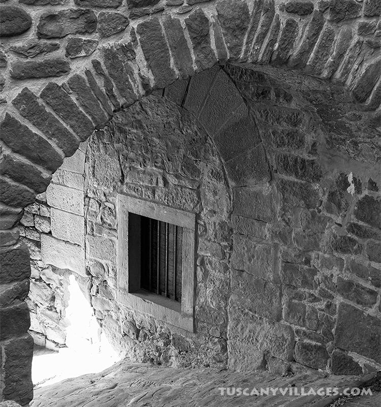 old stone archway in Tuscan Village Fibbialla