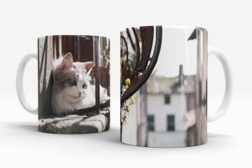 Cat on a hot window ledge mug left and right handle