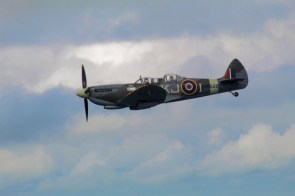 Spitfire in flight KJ-I SM520