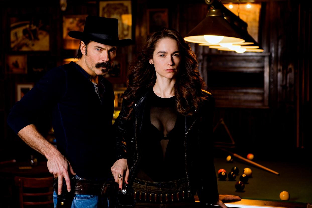 Tim Rozon as Doc Holliday and Melanie Scrofano as Wynonna Earp