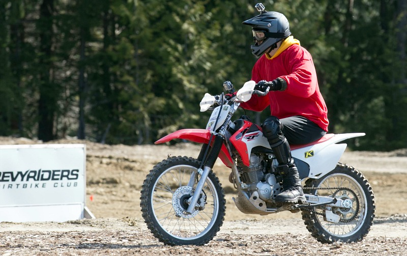A man rides a dirt bike.