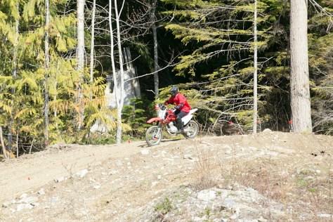 A man rides a dirt bike.