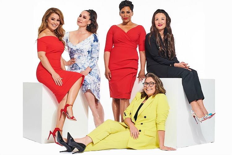 Five women sit, smiling.