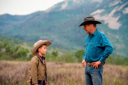 (L-R) Brecken Merrill as Tate Dutton and Kevin Costner as John Dutton.
