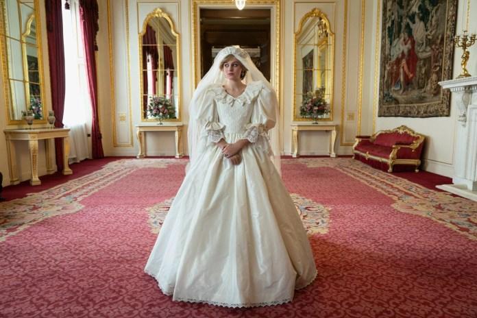 Emma Corinne is wearing a ruffled white dress