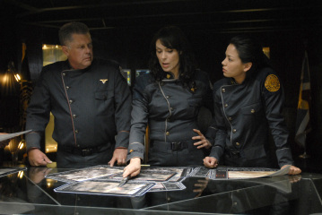 "BATTLESTAR GALACTICA - Graham Beckel as Col. Fisk, Michelle Forbes as Admiral Cain, and Stephanie Jacobsen as Kendra Shaw in ""Razor"""