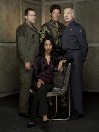BATTLESTAR GALACTICA - Aaron Douglas as Tyrol, Michael Trucco as Sam Anders, Rekha Sharma as Tory Foster, Michael Hogan as Col. Saul Tigh