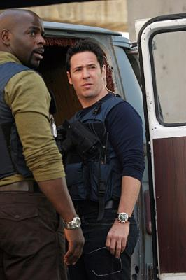 "NUMB3RS - Alimi Ballard as David and Rob Morrow as Don in ""Black Swan"""