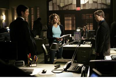 Eddie Cahill as Det. Don Flack, Melina Kanakaredes as Stella and Gary Sinise as Mac.
