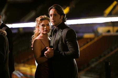 Sophia Myles as Beth Turner and Alex O'Loughlin as Mick St. John