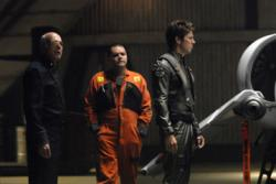 Michael Hogan as Col. Saul Tigh, Aaron Douglas as Tyrol, Michael Trucco as Anders