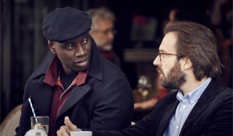 """Da sinistra: Assane (Omar Sy) e Ben (Antoine Gouy) in una scena della seconda parte di """"Lupin"""". Credits: Emmanuel Guimier/Netflix."""