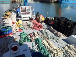 the contents of the forepeak strew over the foredeck for sorting.