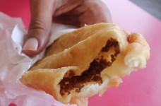 Pastechi Island: Curaçao Pastechi is fried dough stuffed with chicken, fish, or ground beef and/or cheese with a tender center and crispy, flaky crust. It is a breakfast favorite in the Dutch Caribbean islands, but is mostly associated with Curaçao. Photo Courtesy of Sheedia Jansen