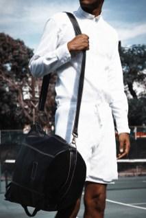 White cotton mesh raglon long sleeved shirt with white drawstring summer shorts.Bag: Kyu Melange (USA) Location: Liguanea ClubPhotographer: Wade Rhoden