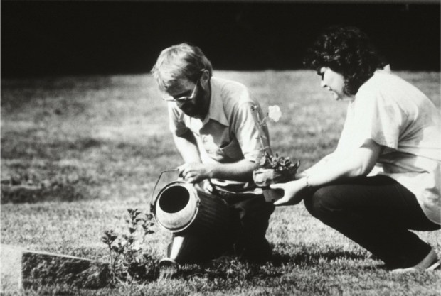 Henningson and Hanson-Jenniges plant a petunia in Hanson's memory at the grave of Hanson's mother in the cemetery of Barness Lutheran Church. (Pioneer Press: Jean Pieri)