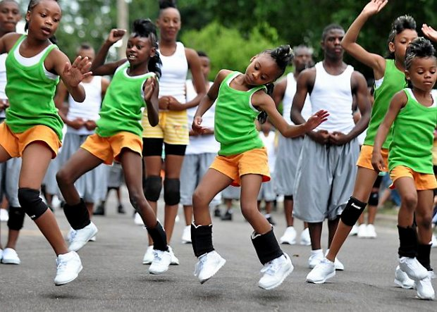 Members of the Half Pintz drill team perform during the Rondo Days Parade in St. Paul, Minn., on Saturday, July 18, 2009. (Pioneer Press: Ben Garvin)