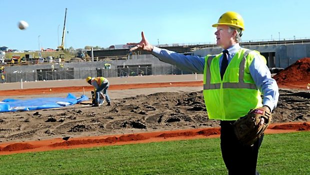 St. Paul Mayor Chris Coleman tosses a ball to St. Paul Saints mascot Mudonna, not seen, during a media tour of CHS Field as workers begin laying 95,000 square feet of sod for the future Saints field in Lowertown on Wednesday, Oct. 8, 2014. (Pioneer Press: Jean Pieri)