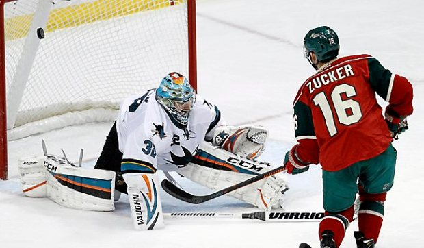 Minnesota Wild left wing Jason Zucker scores on San Jose Sharks goalie Alex Stalock during the first period at Xcel Energy Center in St. Paul on Tuesday, Jan. 6, 2015. (AP Photo/Ann Heisenfelt)