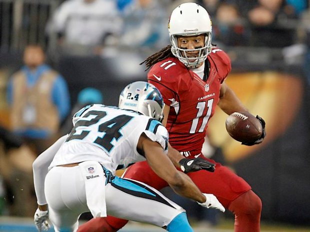 Arizona Cardinals' Larry Fitzgerald (11) looks to slip past Carolina Panthers' Josh Norman (24) during the first half of an NFL wild card playoff football game in Charlotte, N.C., Saturday, Jan. 3, 2015. The Panthers won 27-16. (AP Photo/Bob Leverone)