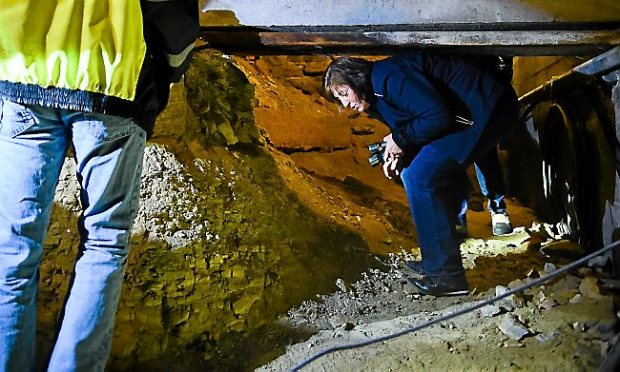 St. Paul Public Works director Kathy Lantry crouches to get under a beam during a tour March 16, 2015, beneath Kellogg Avenue. (Pioneer Press file)