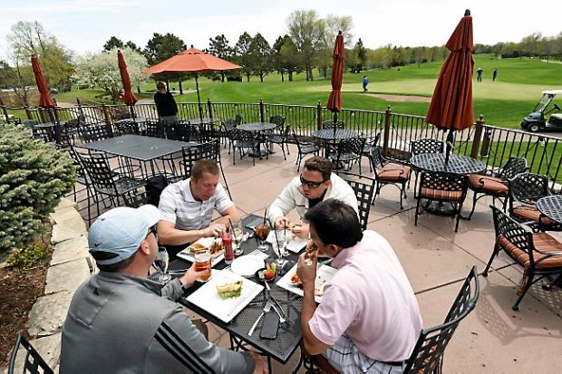 From left: Kyle Nielsen of Minnetonka, Tony Thole of Woodbury, Darren Palmer of Minneapolis and Jim Schmidt of Hudson, Wis., enjoy lunch on the patio at the Prestwick Golf Course in Woodbury in May. (Pioneer Press: Scott Takushi)