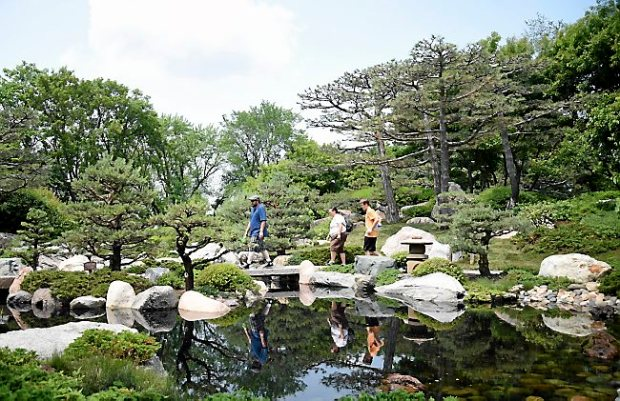 Dan Anderson, Kristianna Anderson and Nikolas O'Donnell of Colorado Springs walk through the Japanese Garden at Como Park Zoo and Conservatory in St. Paul on Monday, June 8, 2015. (Pioneer Press: Holly Peterson)