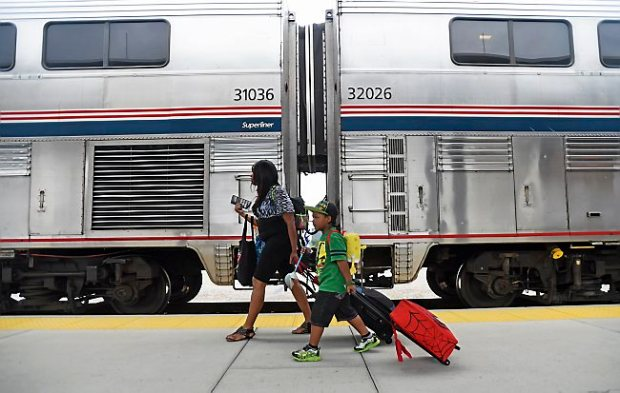 A mother and son walk to board Amtrak's Empire Builder train at St. Paul's Union Depot on July 16, 2015. (Pioneer Press: Holly Peterson)