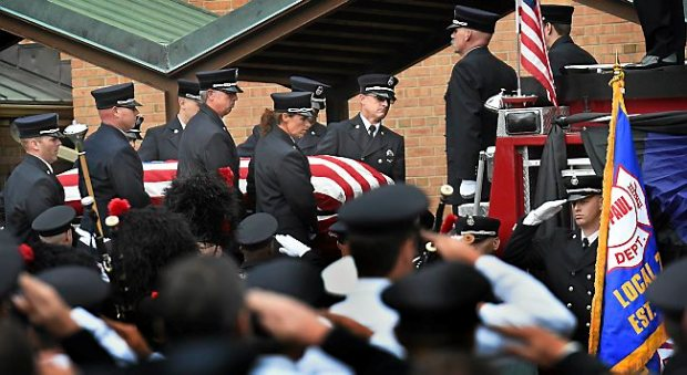The casket bearing the body of St. Paul firefighter/paramedic Shane Clifton is carried to a fire truck outside Gustavus Adolphus Lutheran Church in St. Paul after funeral services Wednesday Sept. 9, 2015. (Pioneer Press: Jean Pieri)