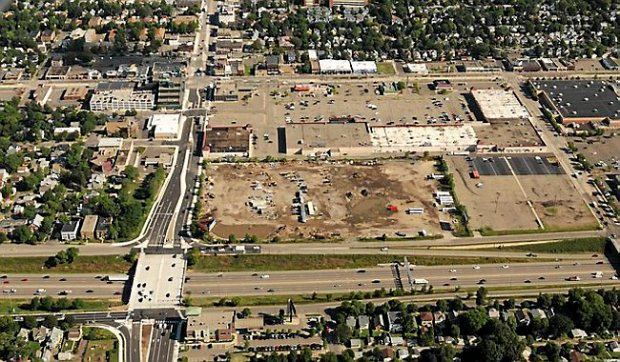 An aerial shot shows at center the former Metro Transit bus barn site, the future home of a Major League Soccer stadium, at the intersection of Snelling Avenue (running vertically to its left) and Interstate 94 in the foreground. University Avenue runs horizontally at top of the frame, in this photograph from August 2015. (Pioneer Press: Scott Takushi)