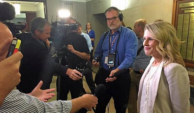 Rep. Tara Mack, right, talks with reporters in September 2015 at the Capitol. It was her first public appearance since citations she and Rep. Tim Kelly received for allegedly  making out  in a Dakota County park became public. (Pioneer Press: David Montgomery)