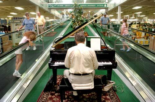 Pianist Steve Gores entertains customers at the Menards home-improvement store in St. Paul'sMidway area. (JOHN DOMAN, Pioneer Press)