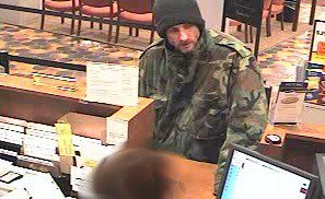 The FBI released this image of Steven Smialek robbing the TCF Bank branch in Fridely in April 2008. He has now been arrested for robbing the same bank again, police say. (Courtesy of the Federal Bureau of Investigation)