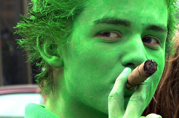 Jake Zappa of St. Paul puffs on a Cuban cigar as he watches the St. Patrick's Day Parade in downtown St. Paul on March 17, 2009.(Pioneer Press: Ben Garvin)
