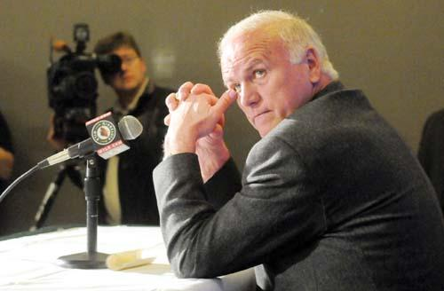 Wild head coach Jacques Lemaire surrepticiously wipes a tear away from his eye as GM Doug Riseborough extoolls the virtues of the departing coach at a press conference Monday morning April 13, 2009 at the Expo Center. (PIONEER PRESS: JOHN DOMAN)